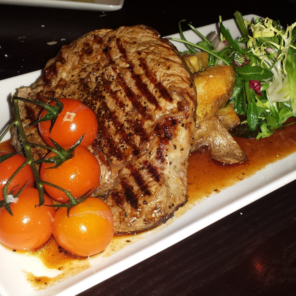 Scottish Rib Eye Steak with Hand Cut Chips, Grilled Baby Tomatoes, Redcurrant Jus and Rocket Salad £22.50